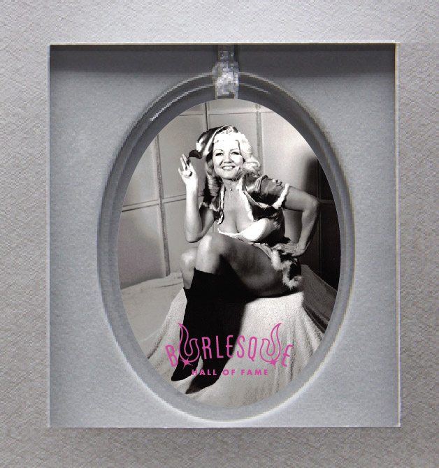 Holiday ornament featuring Jennie Lee in Santa costume