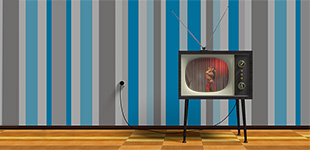 A 1950s TV sits on a wood floor in front of blue and gray striped wallpaper, playing a burlesque performance