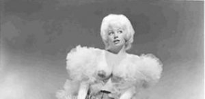 Detail of photo of Dixie Evans wearing boa