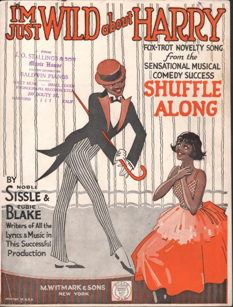 "Cover page of printed sheet music for ""I'm Just Wild About Harry"". Features lithographed image of well-dressed black man with cane and tails standing next to a black woman in red gown, apparently kneeling."