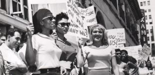 Jennie Lee and other dancersprotest in front of the LA Herald-Examiner, 1959